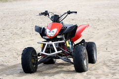 Quadricycle in the sand 2 Stock Photo