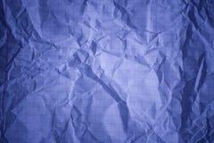 Quadriertes violettes Notizbuchblatt Stockfotos