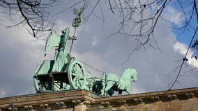 The Quadriga of Brandenburg Gate Behind Branches And Leaves In Berlin, Germany stock footage