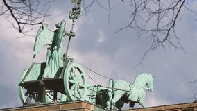 The Quadriga of Brandenburg Gate Behind Branches In Berlin, Germany, Zoom Out stock footage