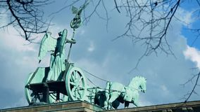 The Quadriga of Brandenburg Gate Behind Branches And Leaves In Berlin stock video footage