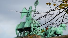 The Quadriga of Brandenburg Gate Behind Branches And Leaves In Berlin, Zoom Out stock video