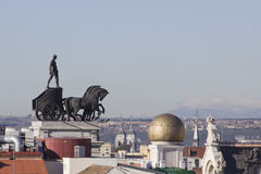 Quadriga in the sky of Madrid. Riding on a chariot on the horizon Royalty Free Stock Image