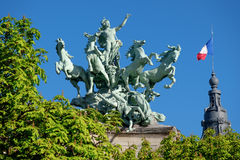 Quadriga statue on top of the Grand Palais in Paris. L`Immortalite devancant le Temps Royalty Free Stock Photos