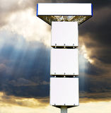 Quadriple billboard on background of stormy skies Royalty Free Stock Image