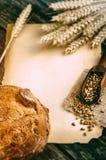 Quadro agrícola com pão e trigo Fotografia de Stock