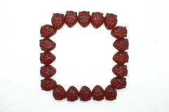 Quadro, beira da geleia vermelha da morango do gummi Fotos de Stock Royalty Free
