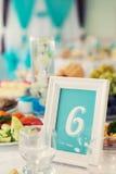 Quadro com número em uma tabela do alimento no restaurante Fotografia de Stock
