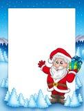 Quadro com o presente de Santa e de Natal Foto de Stock Royalty Free