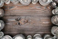 Quadro com vidros da água na tabela de madeira Fotografia de Stock Royalty Free
