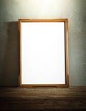 Quadro da foto na tabela de madeira sobre o fundo do grunge Fotografia de Stock