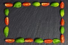 Quadro da manjericão, tomate Imagem de Stock