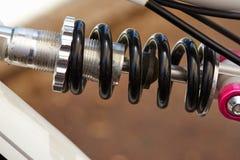 Quadro das peças da bicicleta e fragmento da mola fotografia de stock