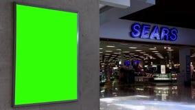 Quadro de avisos verde para seu anúncio na frente da loja dos gatilho filme