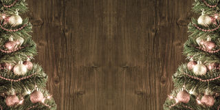 Quadro de duas árvores de Natal sobre o fundo de madeira velho da parede Imagem de Stock