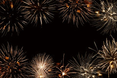 Quadro de fogos-de-artifício dourados, fundo preto da noite Foto de Stock