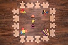 Quadro de madeira do enigma que esrlylearning fotos de stock