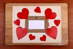 Quadro de mensagens com formas do coração Fotografia de Stock