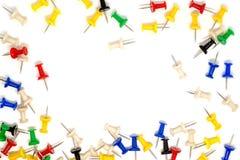 Quadro de multicolour dos pinos do impulso no fundo branco Fotografia de Stock Royalty Free