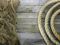 Quadro de rolos da corda e de rede de pesca fotos de stock royalty free