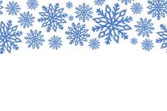 Quadro do Natal com flocos de neve azuis Beira de confetes da lantejoula Imagens de Stock Royalty Free