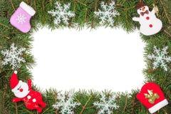 Quadro do Natal feito dos ramos do abeto decorados com flocos de neve boneco de neve e Santa Claus isolados no fundo branco Fotografia de Stock Royalty Free