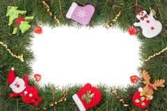 Quadro do Natal feito dos ramos do abeto decorados com o boneco de neve e a Santa Claus isolados no fundo branco Foto de Stock Royalty Free
