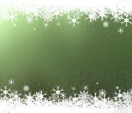 Quadro dos flocos de neve no fundo verde Fotografia de Stock
