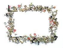 Quadro dos parafusos e dos parafusos no branco Fotografia de Stock