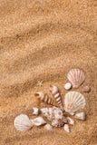 Quadro dos vários escudos na areia imagens de stock royalty free