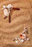 Quadro dos vários escudos na areia fotos de stock royalty free