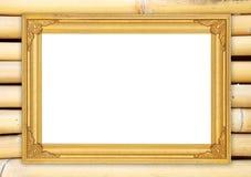 Quadro dourado vazio na parede de bambu colorida Imagens de Stock