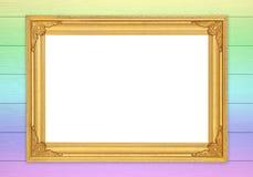 Quadro dourado vazio na parede de madeira colorida Fotografia de Stock