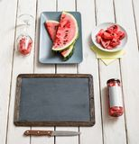 Quadro e caderno em uma mesa com melancia fotografia de stock royalty free
