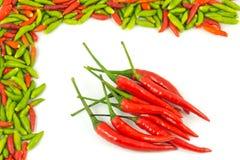 Quadro e fundo quentes das pimentas Fotografia de Stock