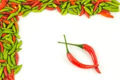 Quadro e fundo quentes das pimentas Foto de Stock Royalty Free