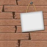Quadro em um fundo de madeira Foto de Stock Royalty Free