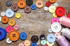 Quadro feito dos botões e das linhas Fotos de Stock