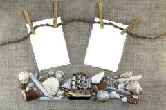 Quadro marinho com pregadores de roupa Imagens de Stock Royalty Free
