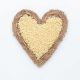 Quadro na forma do coração com painço Imagens de Stock