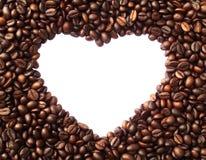 Quadro na forma do coração dos feijões de café Fotografia de Stock Royalty Free