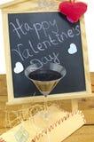 Quadro-negro com corações e e um vidro de vinho Fotos de Stock Royalty Free