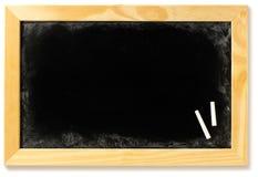 Quadro-negro em branco em um frame com giz Fotografia de Stock