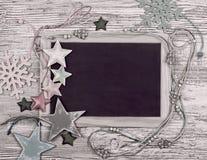 Quadro preto com as várias decorações do inverno fotos de stock royalty free