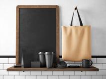 Quadro preto na estante com grupo de elementos de marcagem com ferro quente rendição 3d Imagens de Stock Royalty Free