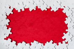 Quadro sob a forma de um retângulo, feito de um enigma de serra de vaivém branco Enigmas do texto e de serra de vaivém do quadro  imagens de stock