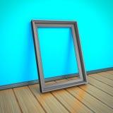 Quadro vazio da imagem ou da foto no assoalho de madeira Fotografia de Stock Royalty Free