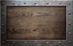 Quadro velho do metal sobre o fundo de madeira Fotografia de Stock Royalty Free