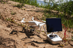 Quadrocopter in the beach. Volga river Royalty Free Stock Photo