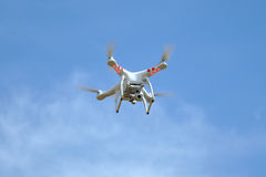 Quadrocopter. On blue sky background Royalty Free Stock Photo